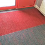 New reception refurbishment containing new flooring with design strip carpet tile and set in entrance matting area.